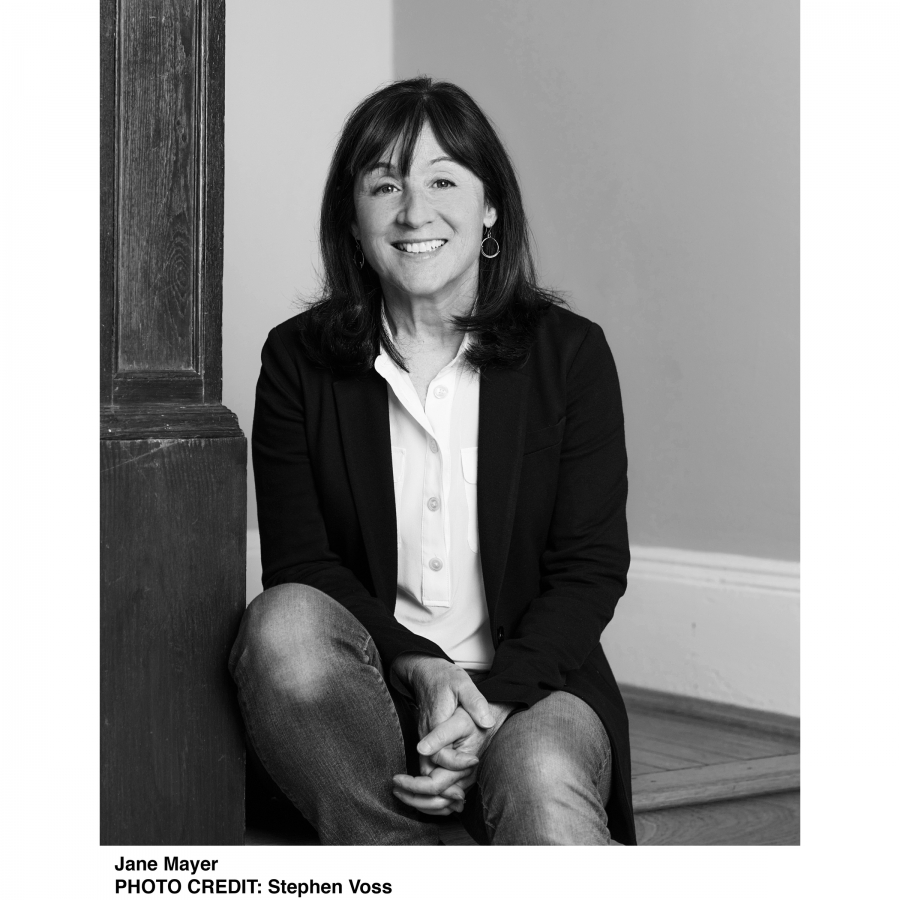 B&W picture of Jane Mayer sitting on a wooden stairs