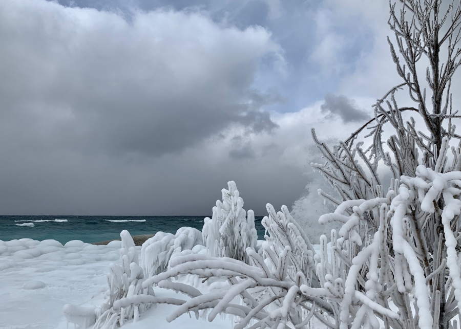 Waves crashing against an icy shore